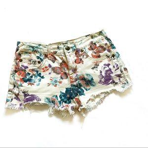 Free People floral print raw hem denim shorts